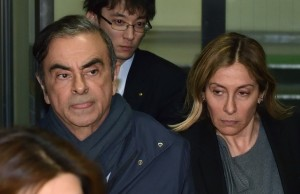 This picture taken on April 3, 2019 shows former Nissan Chairman Carlos Ghosn (L) and his wife Carole (L) leave the office of his lawyer Junichiro Hironaka in Tokyo. - Former Nissan boss Carlos Ghosn will remain in custody until at least April 14, a Japanese court ruled on April 5, 2019, as prosecutors quiz him over fresh allegations of financial misconduct. (Photo by Kazuhiro NOGI / AFP)